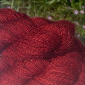 Alpacas of Wales semi solid intense welsh dragon red Suri & Baby Alpaca sport weight yarn. hand dyed by Trisjkelion Yarn